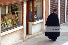 Priest walking in Dorsoduro